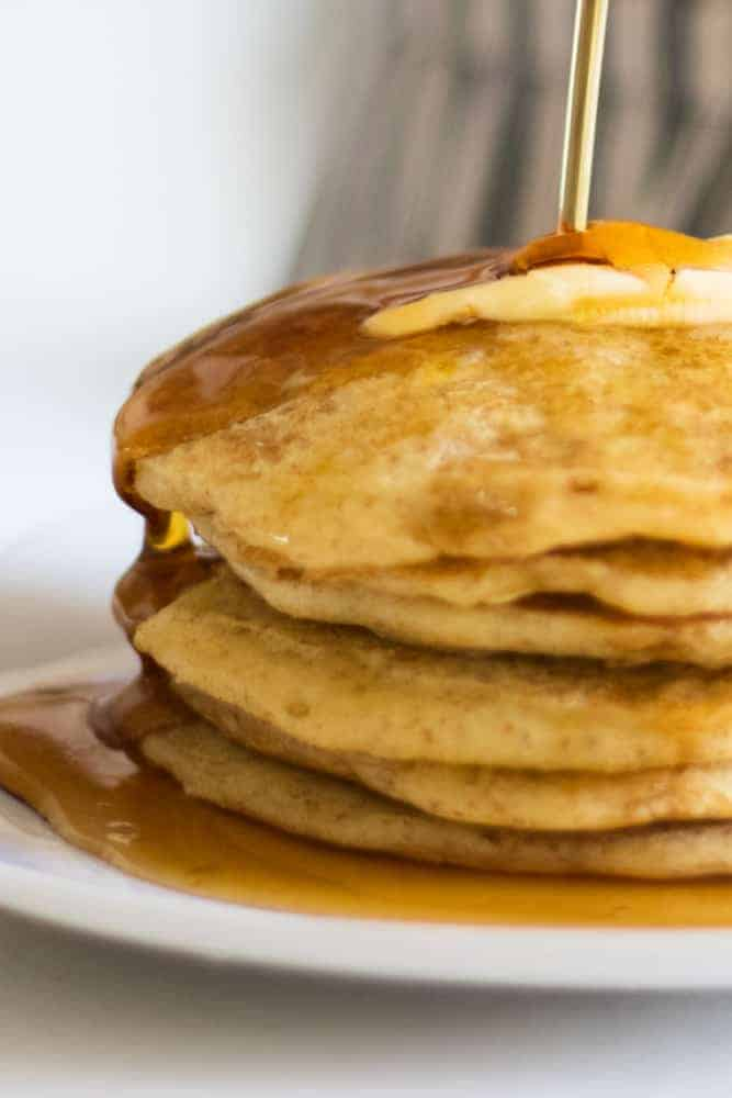 fluffy pancakes dripping with syrup and butter