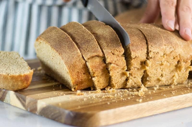 sliced homemade sourdough bread on wooden cutting board