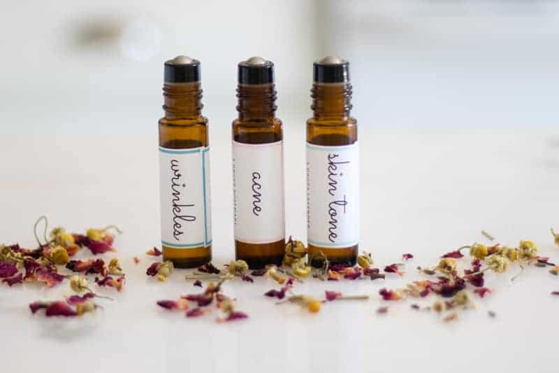 three essential oil roller bottles with labels