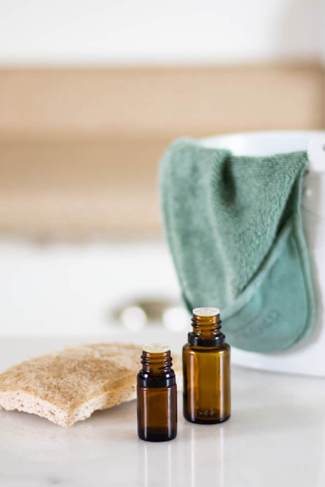 essential oils, scrubbing sponge, and cleaning bucket