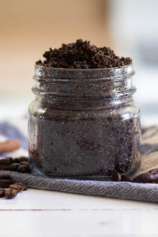 homemade coffee scrub in widemouth mason jar on white shiplap