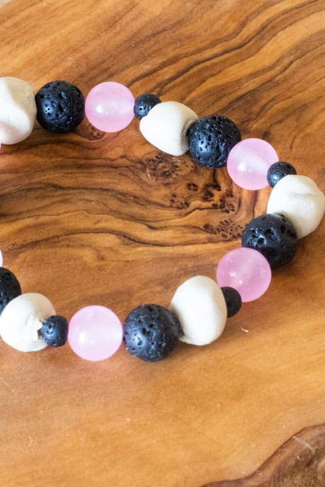 essential oil diffuser bracelet on wood board