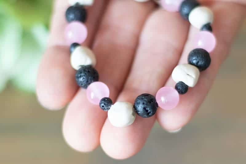 homemade essential oil bracelet in women's hand