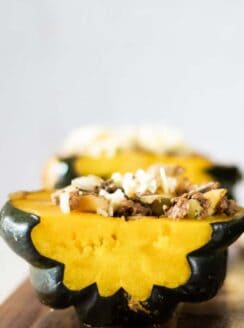 acorn squash with sausage and cheese.