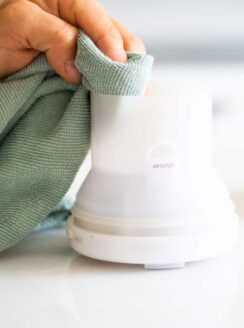cleaning an essential oil diffuser with microfiber cloth