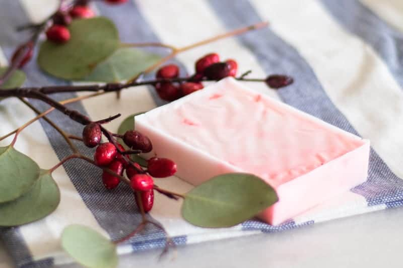 red homemade Christmas soap bar with eucalyptus and cranberries