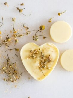 beeswax scented sachet on white marble with dried flowers