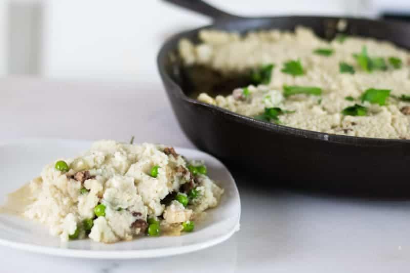 shepherd's pie with cauliflower mashed potatoes on white plate