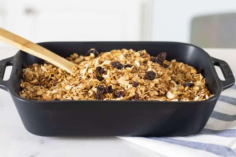 homemade honey granola in black baking dish