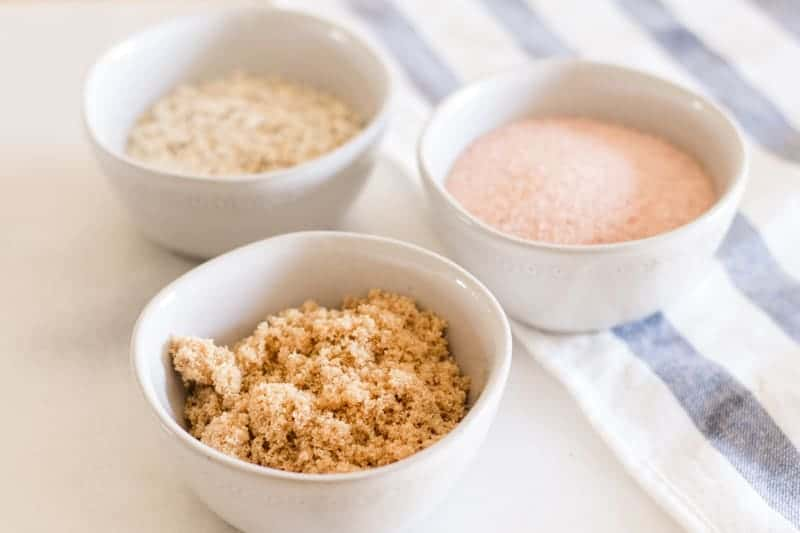 Different scalp exfoliators in small individual bowls.