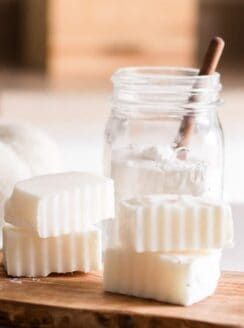Homemade laundry soap bars on wooden board.