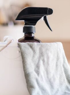 homemade dusting spray in white pail.