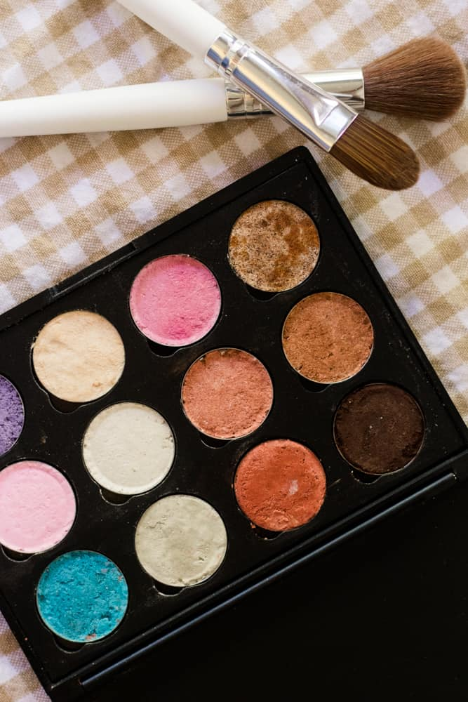 Homemade eyeshadow palette with multiple colors.