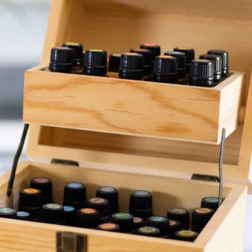 wooden essential oil storage box full of essential oils