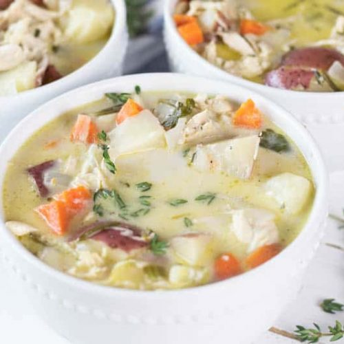 three white bowls of creamy chicken soup
